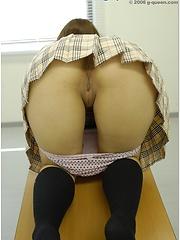 Amazing japanese schoolgirl posing in the classroom