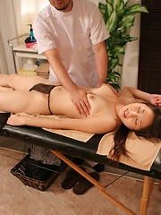 Asian girl moaning on the massage table