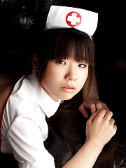 Hikari Azuma Asian shows pussy in tiny thong of nurse uniform