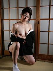 Sayuri Shiraishi posing with her tits out.