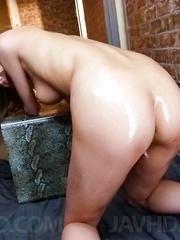 Miku Kohinata Asian with oiled curves puts vibrator on love box