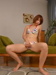 Petite Japanese girl enjoys sucking a dick